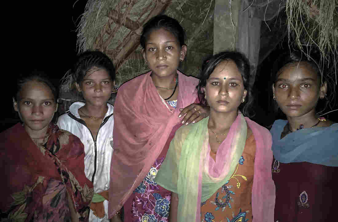Kamala, second from the right in the green and pink scarf, with other menstruating girls by her best friend's shed.