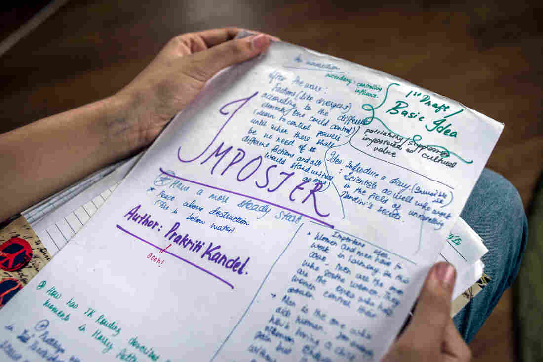 Prakriti Kandel holds the original manuscript for her book, Imposter, in which girls who get their periods also get superpowers.