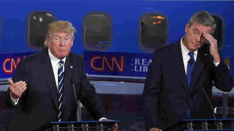 Republican presidential candidates Donald Trump, left speaks at a Republican presidential debate last month, as former Florida Gov. Jeb Bush listens.
