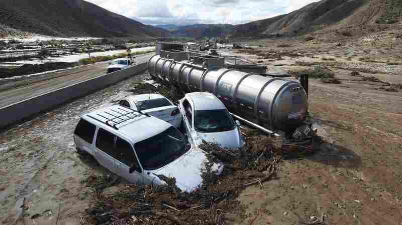 Vehicles are stuck on a road after being trapped by a mudslide on California Highway 58 in Mojave, Calif., on Friday.