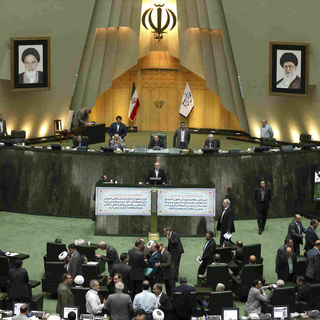 Head of Iran's Atomic Energy Organization Ali Akbar Salehi, center, speaks in an open session of parliament while discussing the bill on Iran's nuclear deal with world powers, in Tehran, Iran, Oct. 11, 2015. Starting Sunday, the approved nuclear deal begins being adopted and implemented.