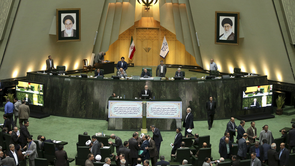 Head of Iran's Atomic Energy Organization Ali Akbar Salehi, center, speaks in an open session of parliament while discussing the bill on Iran's nuclear deal with world powers, in Tehran, Iran, Oct. 11, 2015. Starting Sunday, the approved nuclear deal begins being adopted and implemented. (Ebrahim Noroozi/AP)