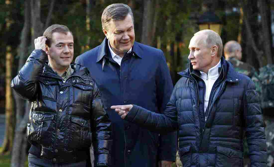 Ukrainian President Viktor Yanukovich (center) meets with Russian leaders Dmitry Medvedev (left) and Vladimir Putin outside Moscow in 2011. Yanukovich had warm relations with Russia, but was ousted amid mass protests in February 2014. Shortly afterward, Putin sent Russian troops into Ukraine, where they seized Crimea.