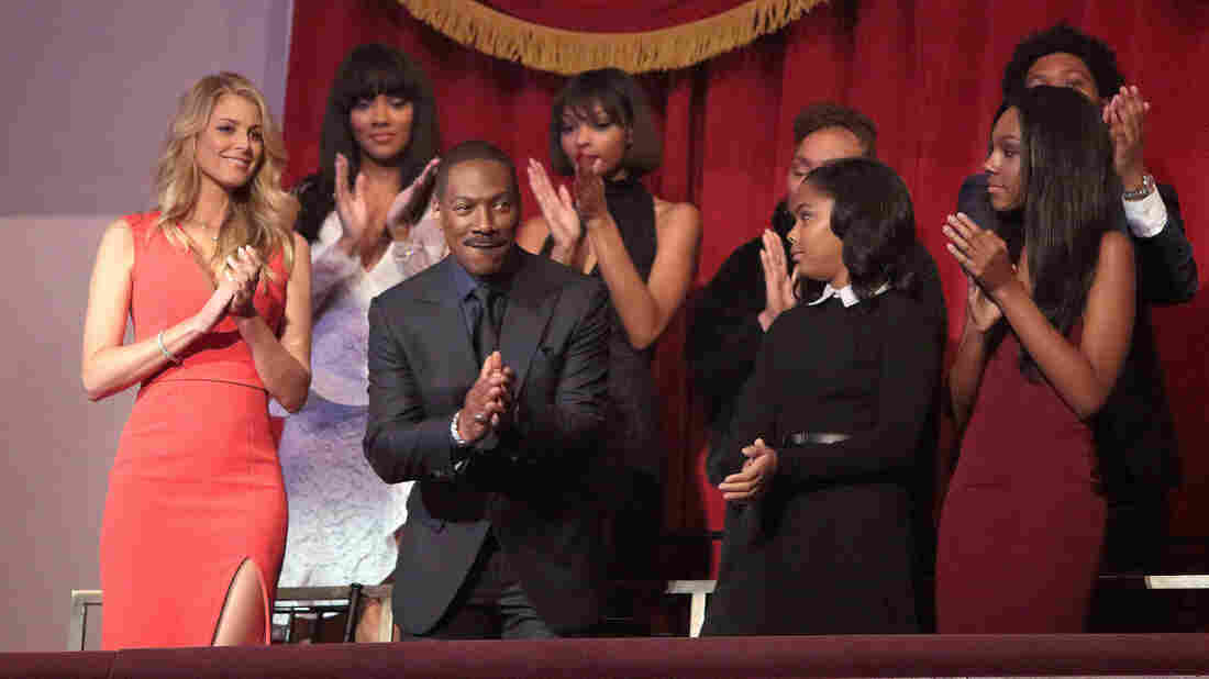 Surrounded by his children, Eddie Murphy is honored with the Mark Twain Prize for American Humor at the Kennedy Center for the Performing Arts on Sunday, in Washington.