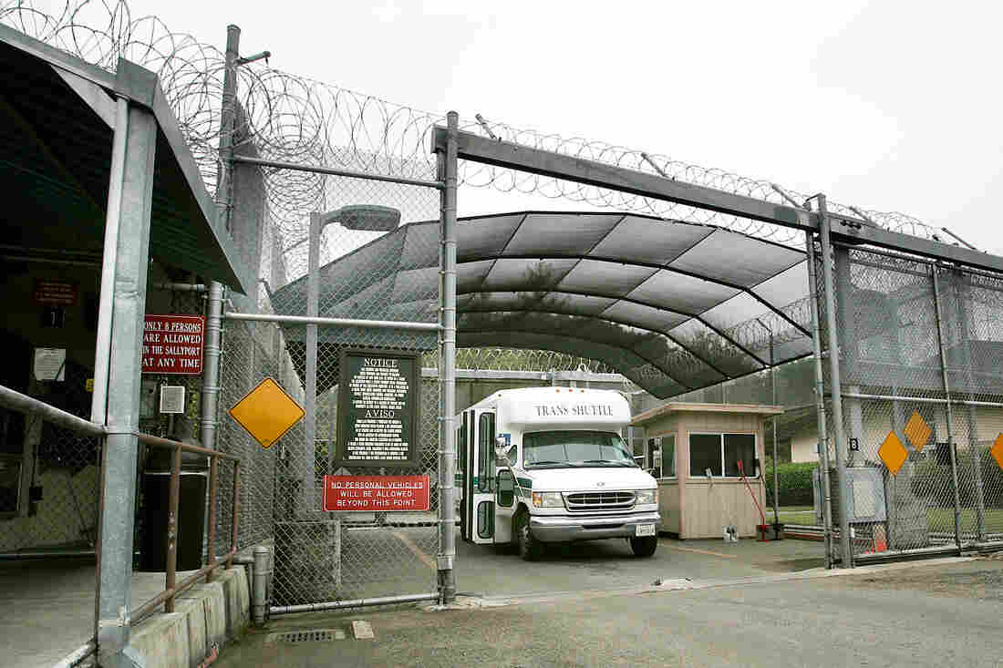 A shuttle bus exits a secure gate at Napa State Hospital after a media tour in 2011.