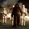 Kylo Ren (Adam Driver) with Stormtroopers.