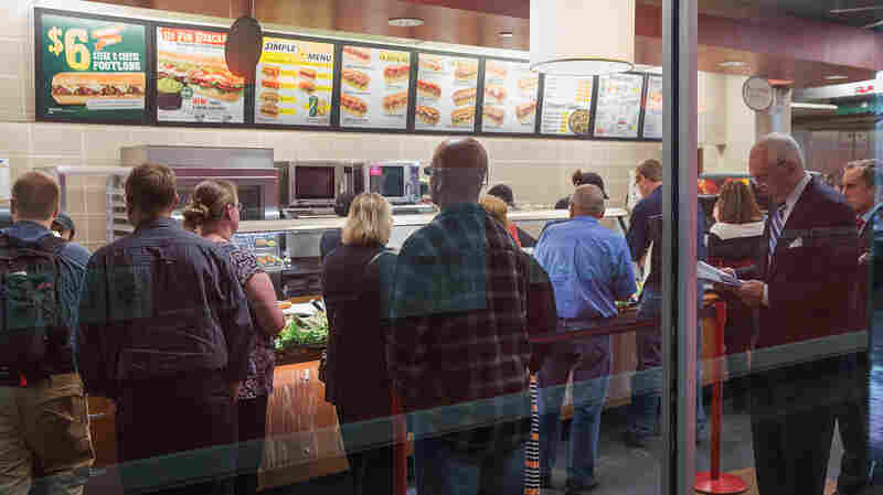 Diners wait in line at a Subway sandwich shop on September 15, 2015 in Chicago, Ill. Subway will serve antibiotic-free turkey and chicken by the end of 2016, but it may take nine years for its suppliers of beef and pork to go antibiotic-free as well.