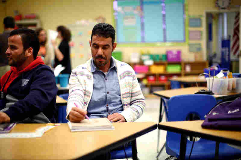 Omar attends an English as a second language class offered by Water for Ishmael, a Christian organization in Toledo.