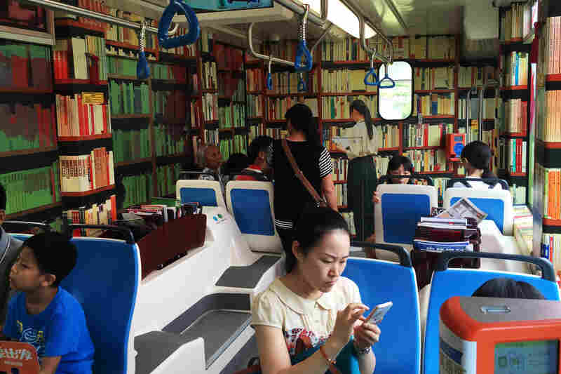 Bookshelves are painted on the walls of a book-themed streetcar in Guangzhou.