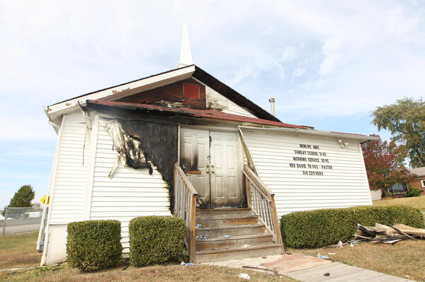 The Newlife Missionary Baptist Church in north St. Louis as it sits with the front burned on Tuesday. A fire damaged the front doors, siding and an entrance to the small predominantly African-American church. (Bill Greenblatt/UPI /Landov)