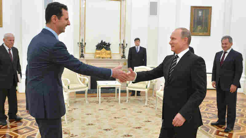 Russian President Vladimir Putin, right, shakes hands with Syrian President Bashar Assad in the Kremlin. Assad was in Moscow, in his first known trip abroad since the war broke out in Syria in 2011, to meet his strongest ally Russian leader Vladimir Putin.
