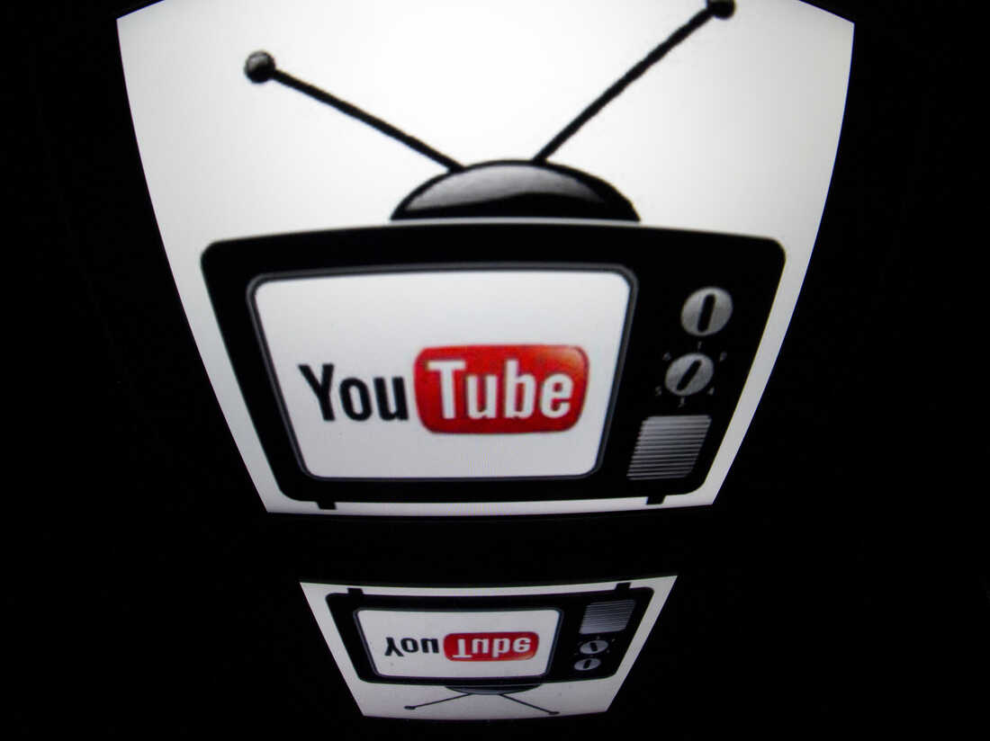 YouTube logo is seen on a tablet screen.