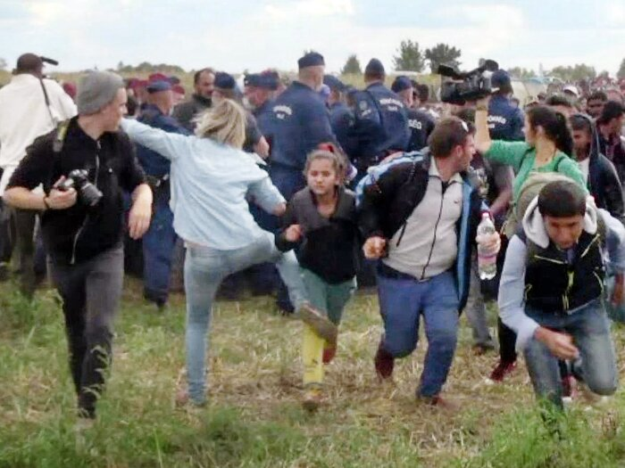 This video grab made on early September shows a Hungarian TV camerawoman kicking a child as she runs with other migrants from a police line during disturbances at Röszke, southern Hungary. (AFP/Getty Images)