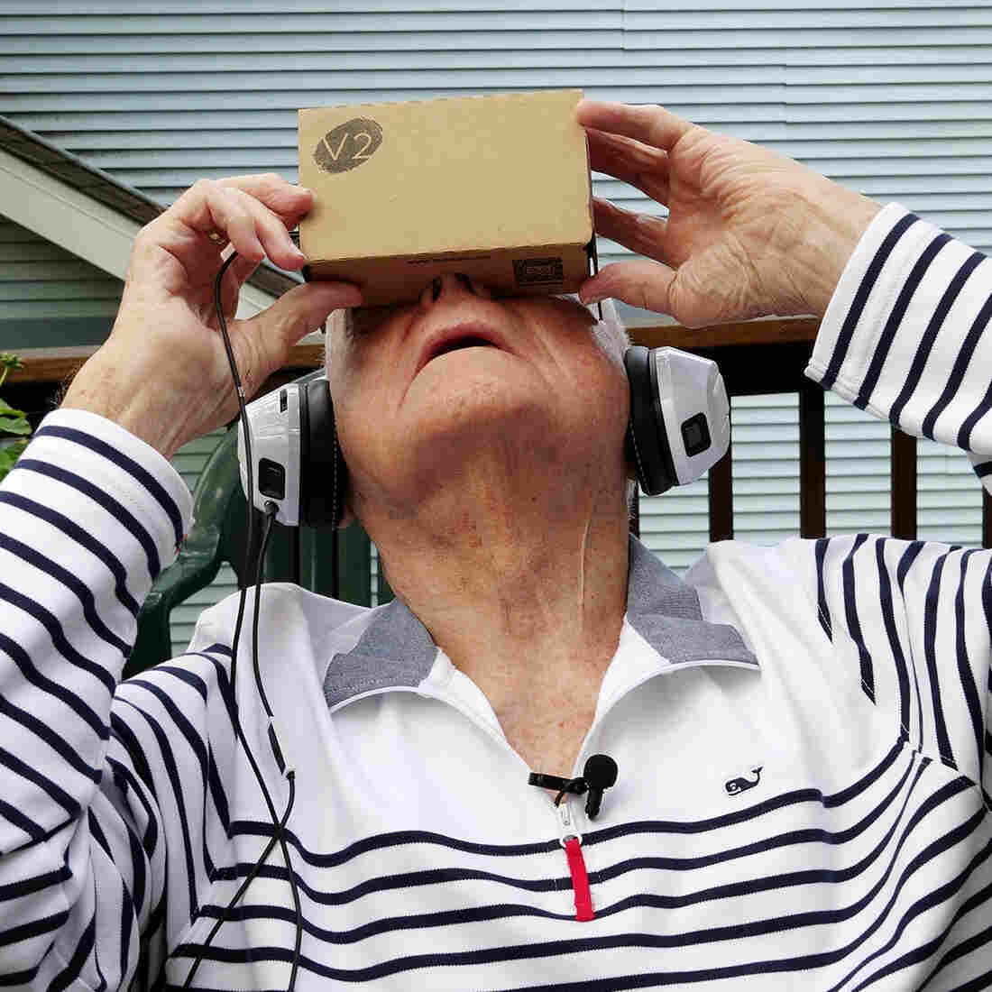 Dale Garrett of Columbia, Mo., a 96-year-old World War II veteran, experiences a trip to a war memorial through virtual reality.