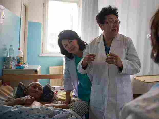 """Dr. Odontuya Davaasuren, right, says that a good death is """"being comfortable, being with loved people, listening to good words. Even an unconscious person listens, because hearing stops last."""""""