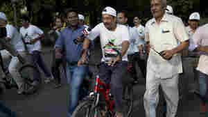 Delhi Chief Minister Arvind Kejriwal, center, takes part in a cycle rally during a car-free day that covered a 4-mile stretch in New Delhi, India, on Thursday.