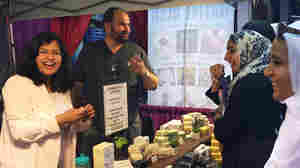 'Asma Khan of Chicago at the booth for her business, Soap Ethics.' from the web at 'http://media.npr.org/assets/img/2015/10/22/img_0486-edit_wide-bf5d9d1276ced8b7b82b94e8707e4555582af795-s300-c15.jpg'