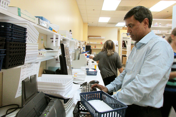 Maryland pharmacist Narender Dhallan often has to decide whether to fill a prescription and lose money or send a customer to another store.