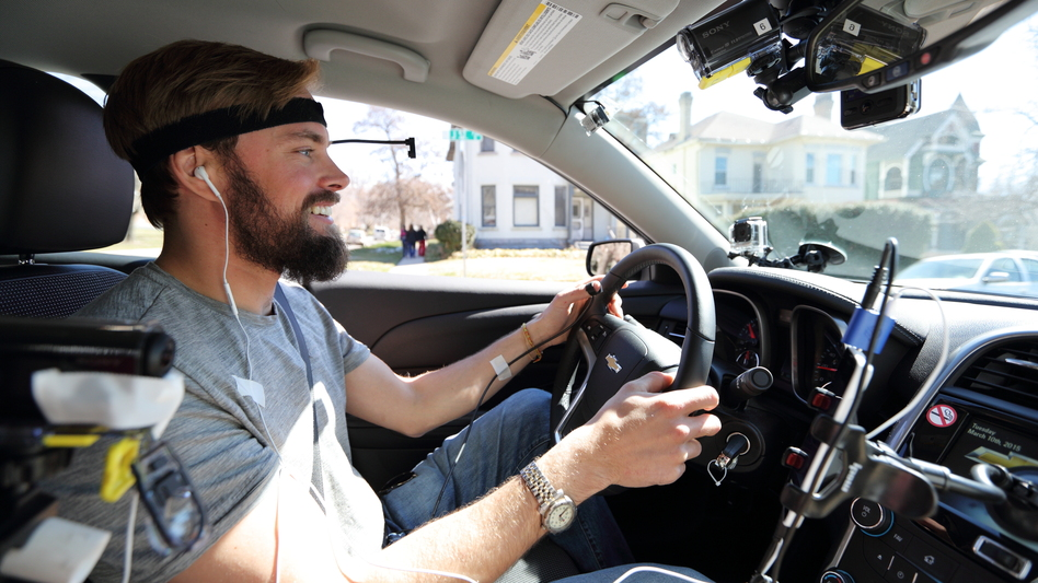 Monitored by researchers and cameras, a study participant drives while using hands-free technology. New AAA research found that these technologies are distracting even after they're used. (Dan Campbell/American Automobile Association )