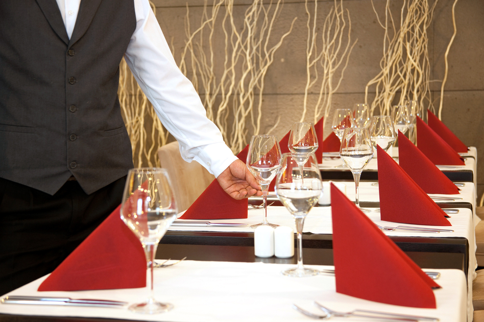 At fine-dining places, white workers overwhelmingly fill jobs with the heftiest salaries, while Latinos, blacks and other minorities have jobs with pay closer to the poverty level, a study finds. (iStockphoto)