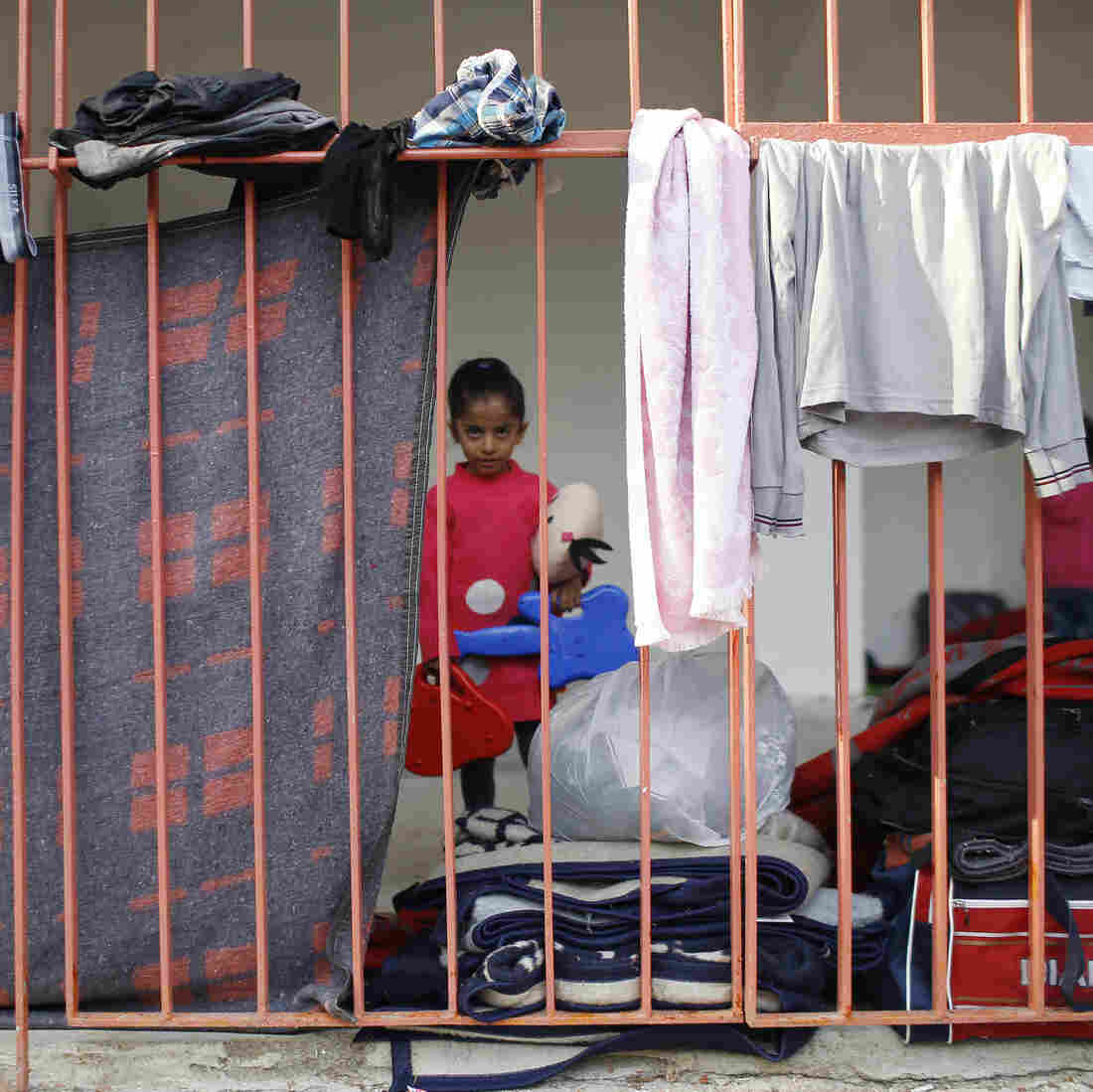 A young girl is among many migrants, most of them Syrian, resting at a sports stadium near Turkey's western border with Greece on Sept. 22. Turkey has taken in some 2 million Syrians fleeing war in their homeland. But Turkey rarely allows the migrants to work or receive citizenship, and many of the Syrians say they want to move on to Europe.