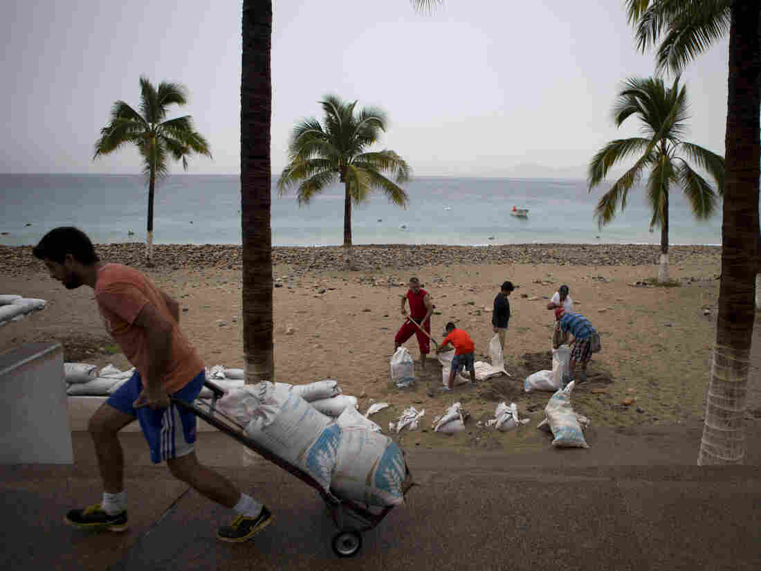 Residents of Puerto Vallarta, Mexico, hauled sandbags on Friday as part of disaster preparations for Hurricane Patricia.