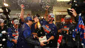 The New York Mets celebrate after sweeping the Chicago Cubs in the National League Championship Series to get to the World Series, which starts Tuesday.