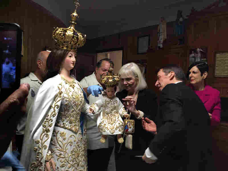Designers Tom and Linda Platt, at right, helped make a glittering new dress for the Madonna.