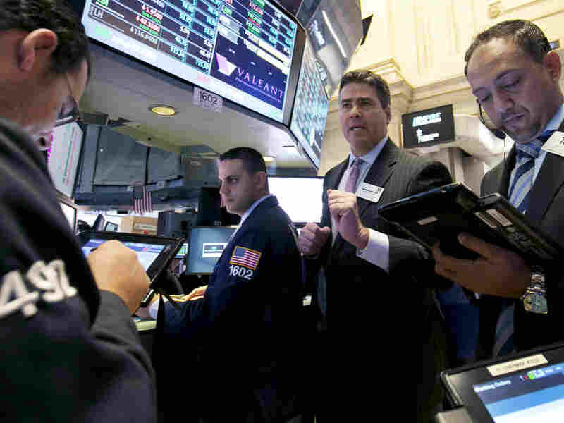 At the New York Stock Exchange, traders watched what was happening to shares of Valeant last Thursday, after questions mounted about the company's practices. NYSE Governor Richard Barry is second from the right.