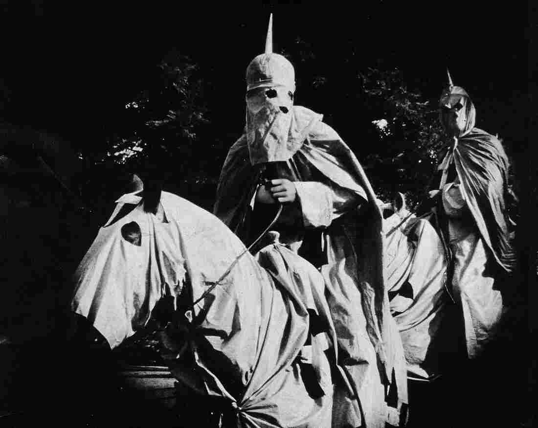 In a still from The Birth of a Nation, two actors dressed in the full regalia of the Ku Klux Klan ride at night. The racist movie, directed by D.W. Griffith, was one of the first feature-length blockbusters in U.S. history. It inspired protests by African-Americans — and gave one man the idea for a response in the same format.
