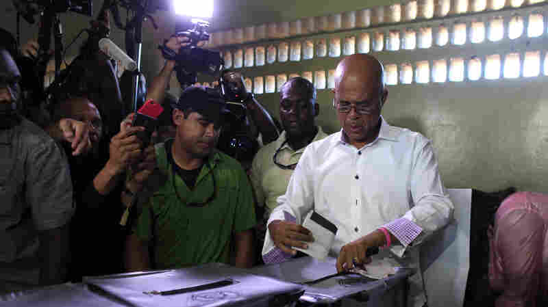 Haiti's President Michel Martelly casts his ballot during elections in the Petion-Ville suburb of Port-au-Prince, Haiti, Sunday. The country is holding the first-round presidential vote Sunday along with balloting for numerous legislative races and local offices.
