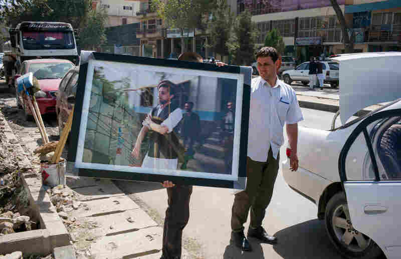 Nickelsberg's photo of Afghan mujahedeen leader Ahmad Shah Massoud is transported to an exhibit in Kabul in August. Massoud was assassinated on Sept. 9, 2001, by al-Qaida operatives disguised as journalists.