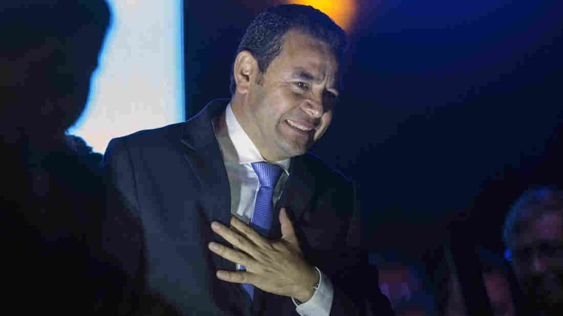 Jimmy Morales, the National Front of Convergence party presidential candidate, gestures to supporters after winning the presidential runoff election in Guatemala City, early Monday.