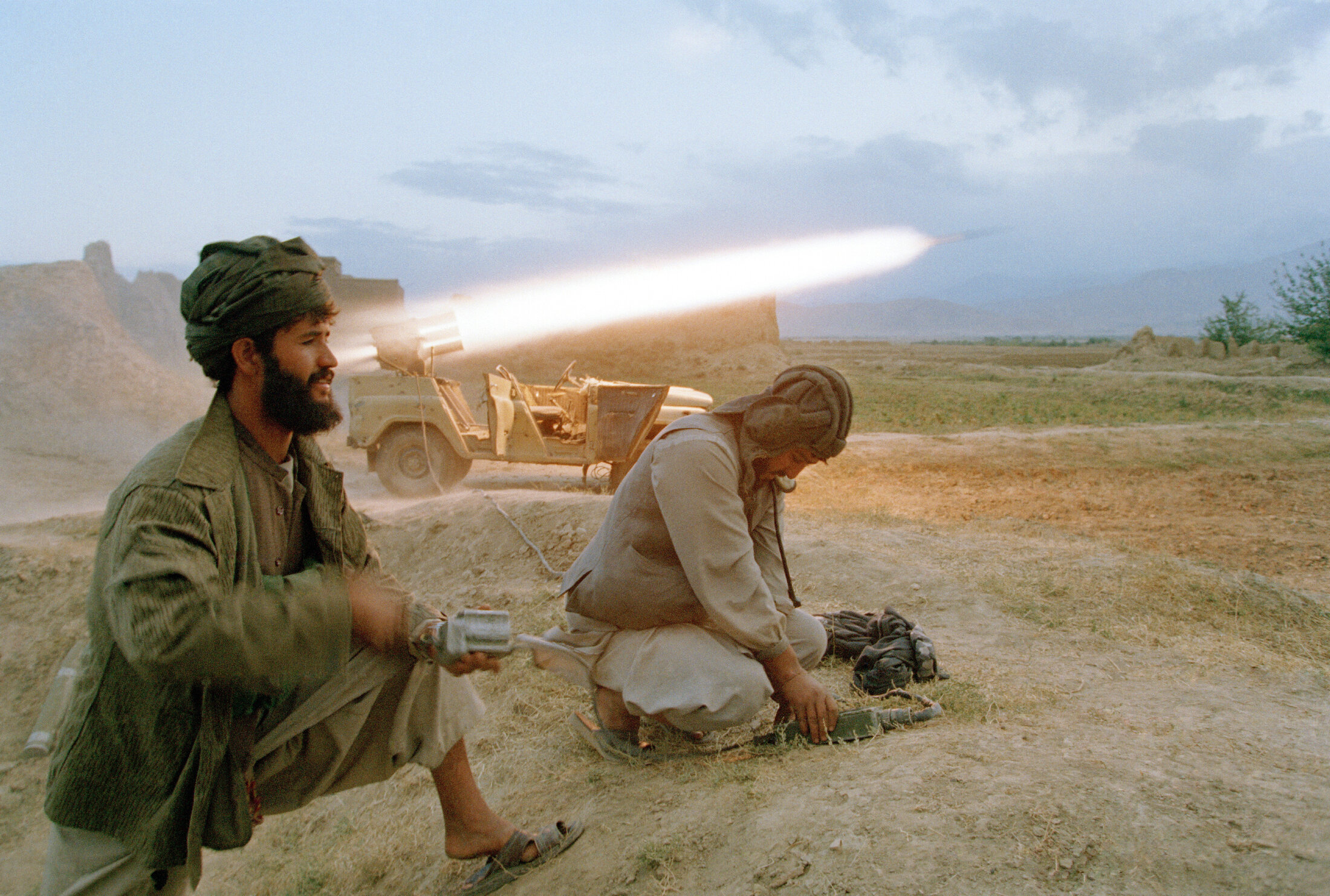 Taliban soldiers fire a rocket at retreating Northern Alliance army forces shortly before taking control of Kabul on Sept. 27, 1996.
