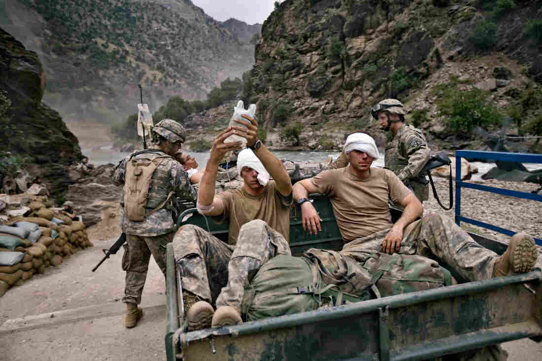 Soldiers from the Army's 10th Mountain Division, wounded in an ambush, await evacuation from Nuristan province in August 2006.