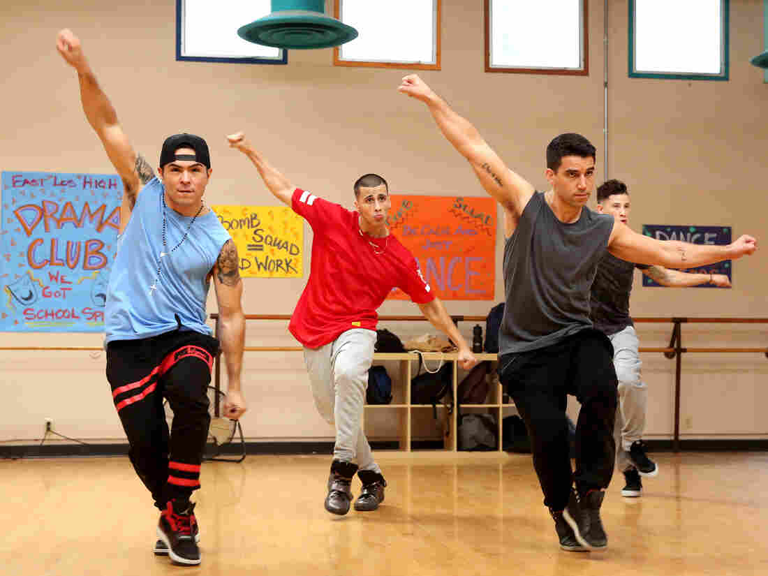 The boys of East Los High's dance team practice their moves.