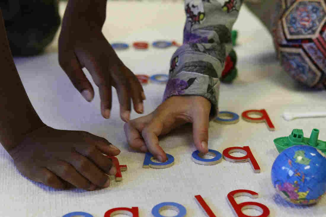 These white floor mats are one hallmark of a Montessori classroom.