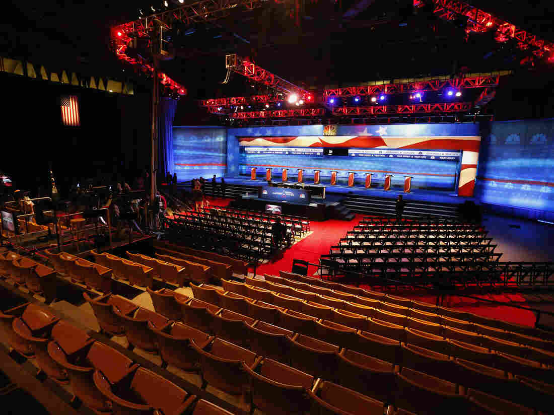 Crews prepare the venue for the CNBC Republican presidential debate inside the Coors Events Center at the University of Colorado.