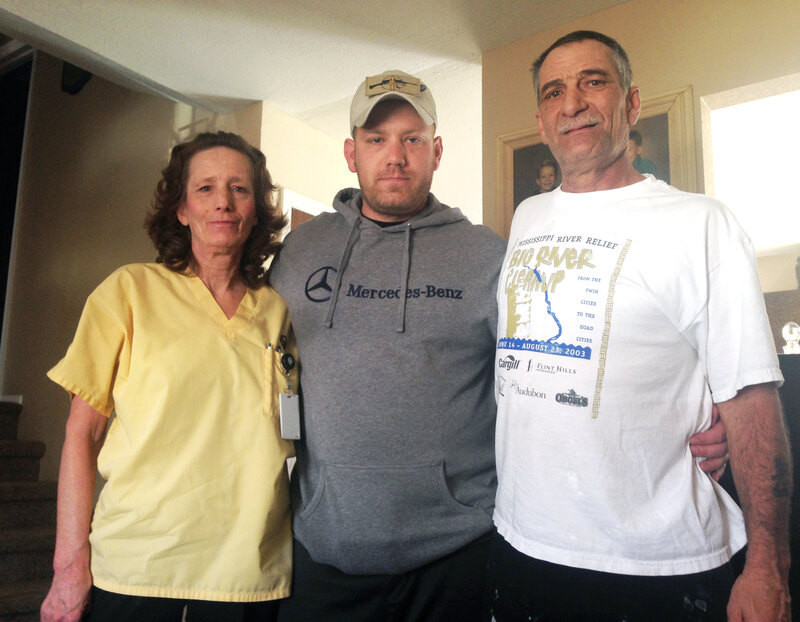 Eric James with his mother, Beverly Morris, and father, Robert James. Eric secretly recorded more than 20 hours of sessions he had with behavioral health specialists and Army officials. (Michael de Yoanna/Colorado Public Radio)