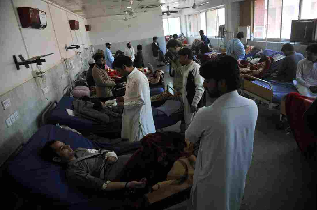 Injured Pakistanis are treated in a hospital in Peshawar on Tuesday.