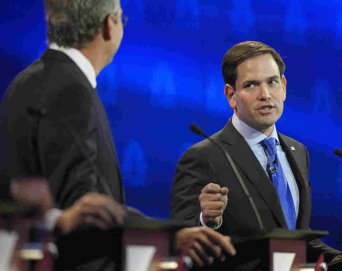 Marco Rubio (right) and Jeb Bush argue a point during the CNBC Republican presidential debate at the University of Colorado in Boulder, Colo., on Wednesday.