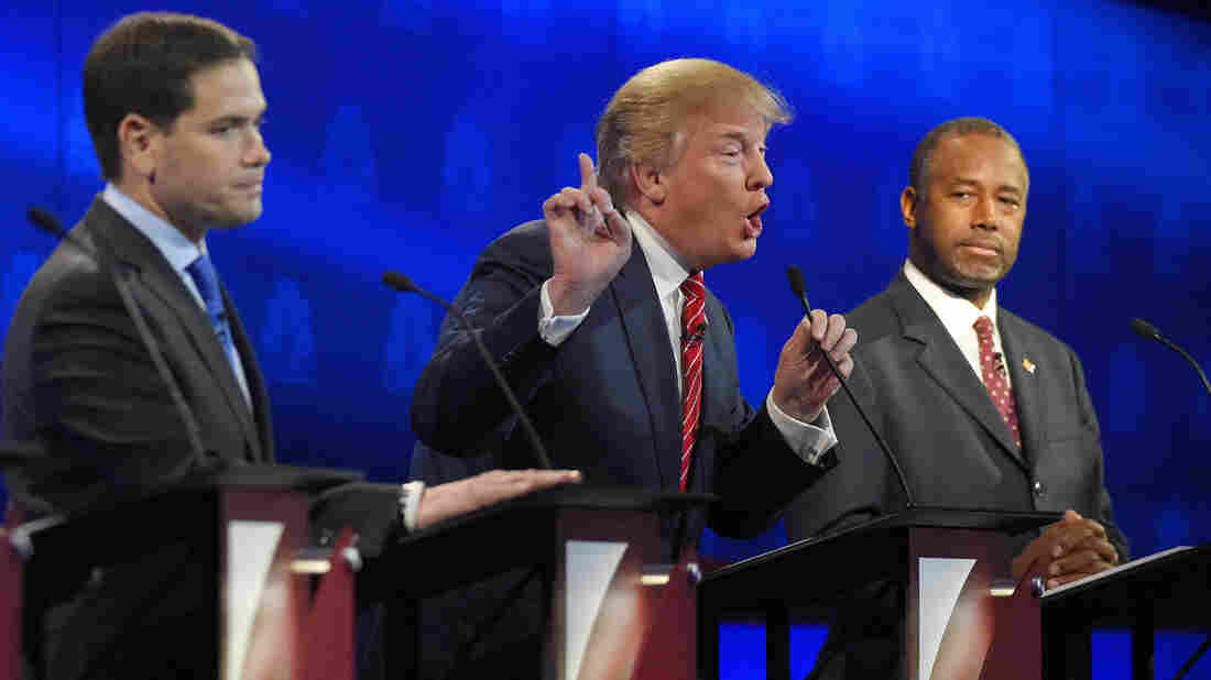 Donald Trump (center) makes a point as Marco Rubio (left) and Ben Carson look on during the CNBC Republican presidential debate at the University of Colorado, Boulder.