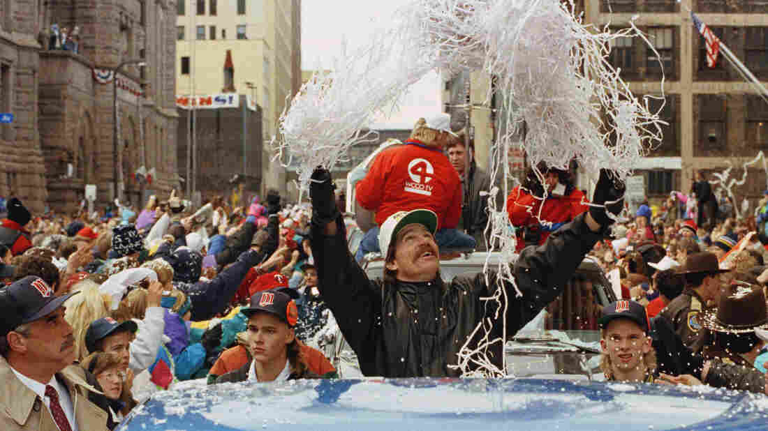 Minnesota Twins pitcher Jack Morris tosses confetti from his pickup truck during a parade celebrating the team's 1991 World Series championship.