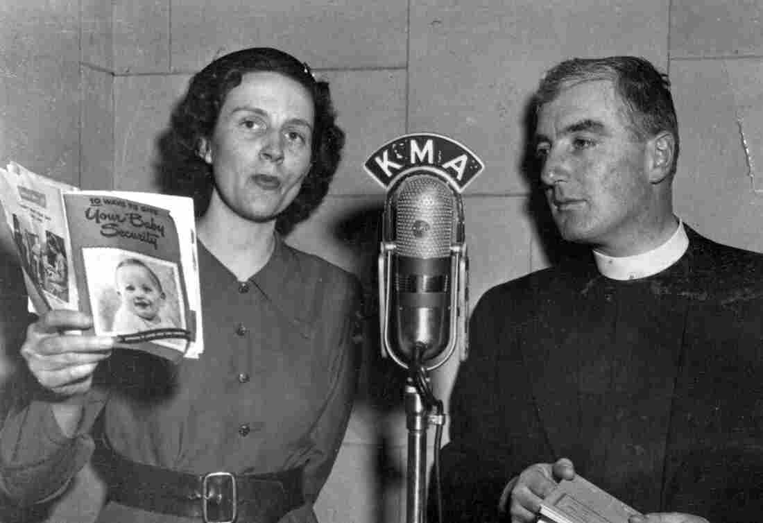 """Birkby and a guest, Vicar Henry Robbins, a local pastor, 1950. """"We were just women who shared our lives,"""" Birkby says of herself and her fellow radio homemakers. """"We shared what we were doing with our families, what we were cooking, what we were eating."""""""