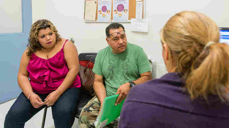 Dr. Janina Morrison, right, speaks with patient Jorge Colorado and his daughter Margarita Lopez about Colorado's diabetes at the Los Angeles County-USC Medical Center.