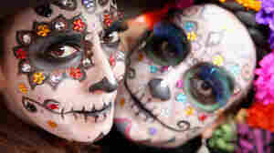 Girls in face paint celebrate Day Of The Dead.