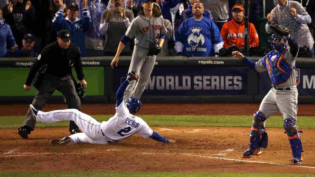 Alcides Escobar of the Royals scores a run on a two-run RBI single hit by Eric Hosmer in the fifth inning of Game Two of the World Series.