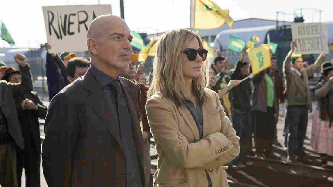 Billy Bob Thornton as Pat Candy and Sandra Bullock as Jane in a scene from Our Brand is Crisis.