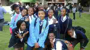 """Zanele Themba (on the left with the pink backpack strap) admires American teens because they """"know what they want and go for it."""" She's posing with classmates from the Sapphire Secondary School who participated in a model U.N. in Johannesburg."""