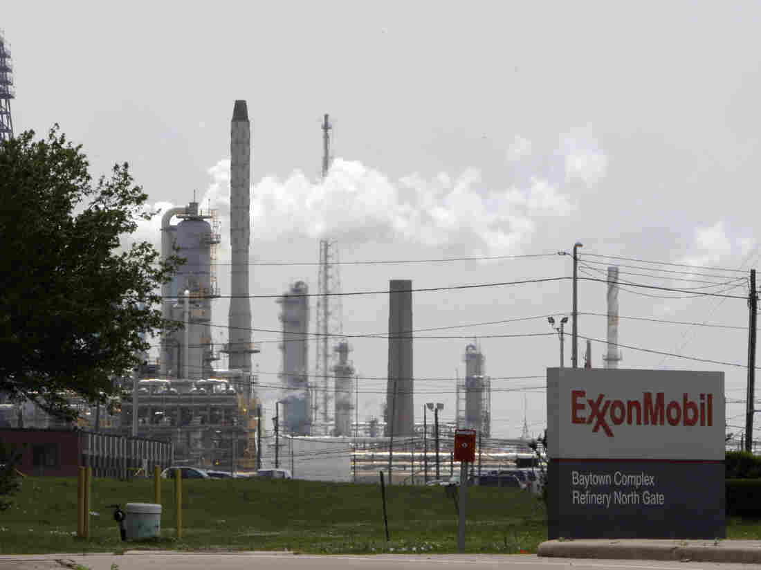 In this 2010 photo, steam rises from towers at an Exxon Mobil refinery in Baytown, Texas. Recently leaked memos from Exxon Mobil have shown that the company knew about climate change as early as 1981 but still funded deniers.